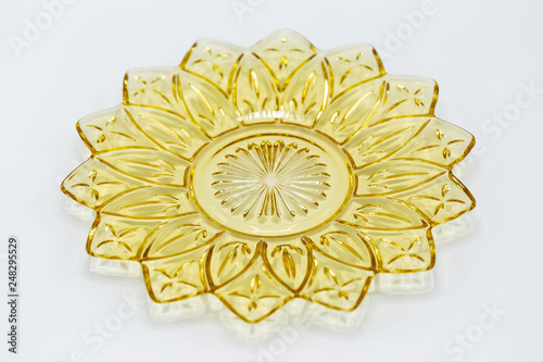 medium size yellow glass serving plate shaped like a flower