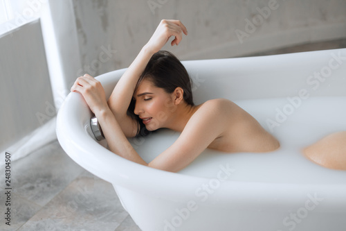 Brunette naked women in the bathtub Beautiful Bathing European Brunette Woman Relaxing In Milky Bathtub Demonstrating Her Naked Shoulder And Arms Stock Photo Adobe Stock