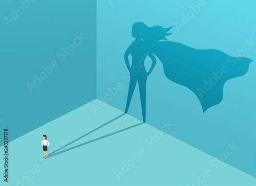 Obraz na plátne Businesswoman with shadow superhero