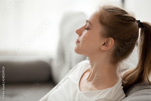 Deurstickers Ontspanning Happy calm woman relaxing breathing fresh air dreaming on couch