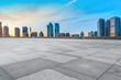 Empty Plaza Floor Bricks and the Skyline of Modern Urban Architecture in Qingdao..