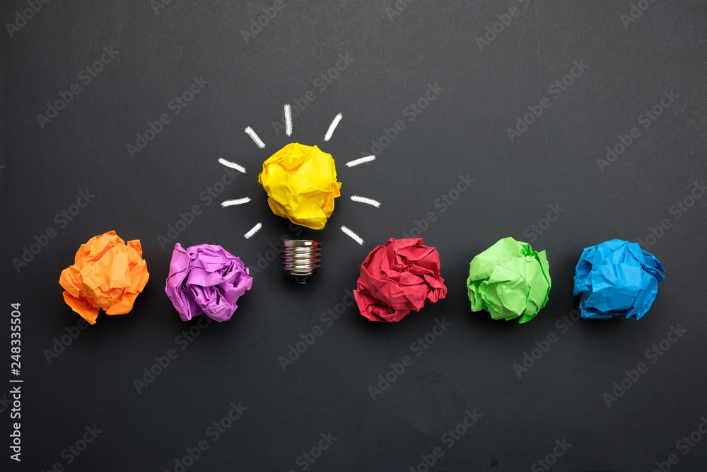 Fototapety, obrazy: Great idea concept with crumpled colorful paper and light bulb on black background