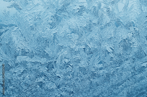 Photo Abstract frosty pattern on glass, background texture