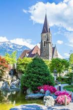 Japanese Garden Of Friendship In Interlaken. View Of The Church Of The Holy Spirit