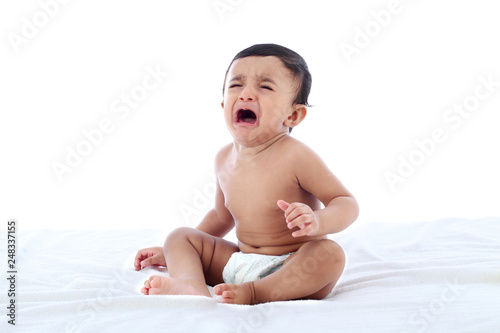 Crying baby boy against white background Canvas