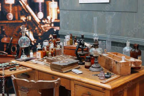 Photo  Old science lab with chemical reagents and burner