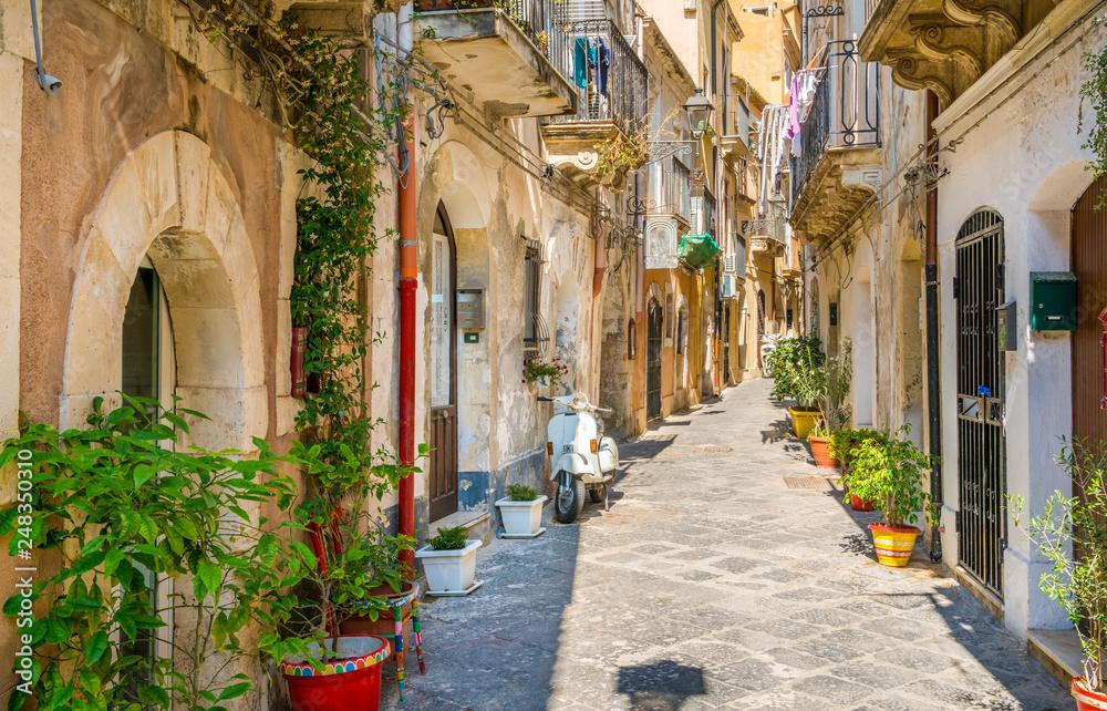Fototapeta Picturesque street in Ortigia, Siracusa old town, Sicily, southern Italy.