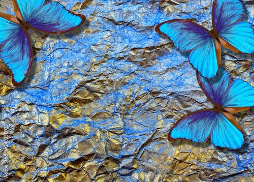 Montage in der Fensternische Schmetterlinge im Grunge morpho butterflies on bright shining background. gold blue texture background. golden crumpled paper.