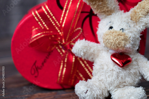 Chocolate box for Valentines Day on wooden background. Gift boxes and soft toy for a Valentines Day #248351103
