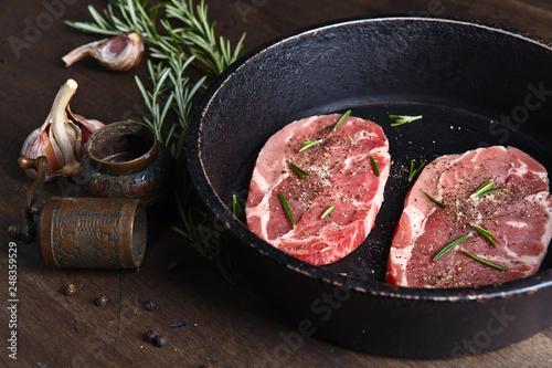 Fotografie, Obraz  Pork steak with rosemary, garlic and pepper
