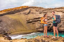 Hikers - Travel Couple Tourists Hiking On Hawaii. Tourist Backpackers Walking On Green Sand Beach, Papakolea On Big Island, Hawaii, USA. Young Happy Couple Traveling With Backpacks.