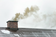 Smoke Coming Out Of The House Chimney