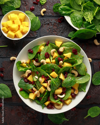 Fototapeta Mango Spinach salad with dried cranberries and nuts. healthy food. obraz