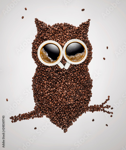 Deurstickers Cafe Cute owl sitting on the branch, made of coffee beans and coffee cups over light gray background with copy space
