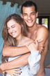 young attractive handsome smiling man and woman hugging in the room