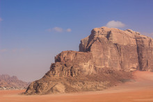 Middle East Steep Picturesque Rock Mountain Yellow Scenic Landscape In Wadi Rum Desert