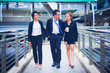 Business team. They are walking on walkway. Photo concept Business team.