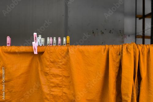 Fotografia  yellow robe of Buddhist monk pattern background