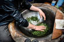 Traditional Tea Making Drying Green Tea In Pan Processing By Hand At Longjing Village In Hangzhou China.