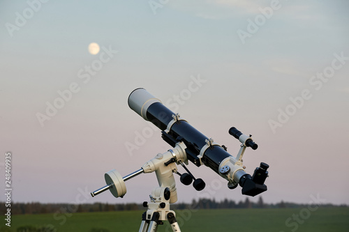 Observation of the stars and the moon through a telescope Canvas Print