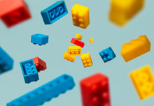 Floating Plastic Geometric Cubes In The Air. Construction Toys On Geometric Shapes Falling Down In Motion.