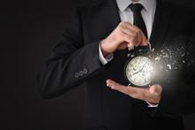 Businessman With Alarm Clock On Light Background, Closeup
