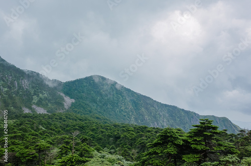 Mountain ridges under clouds and fog on top of Cangshan Mountains in Dali, Yunnan, China