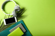 canvas print picture - Mobile phone with headphones and stationery on color background