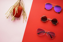 Different Stylish Sunglasses On Color Background