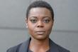 Leinwanddruck Bild - Front bust portrait of young black woman