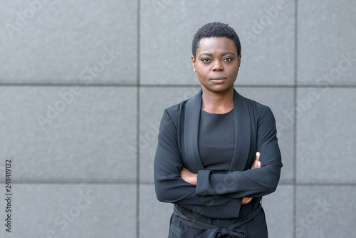 Stern serious young black businesswoman Fotobehang