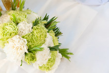 View Of Flower Bouquet On White Table.