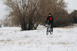 Man on a bike in the winter forest