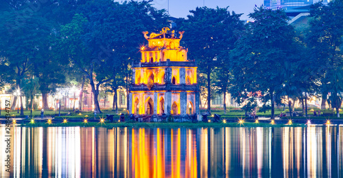 night view of the Turtle Tower in middle of the Hoan Kiem Lake (Lake of the Returned Sword) at historic centre of Hanoi in Vietnam