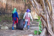 Two Women's Picking Up Garbag.
