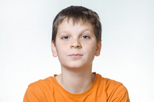 Portrait Of A Boy - A Teenager On A White Background, Close-up, Emotion, Surprise, Doubt