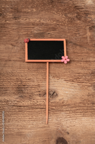 Foto  chalkboard on wooden background with copy space