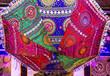 Leinwanddruck Bild - Sun umbrella in Indian style, multicolor souvenir in Dubai