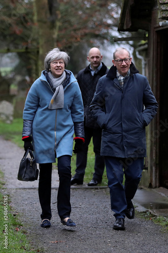 86c93833ab68 Britain s Prime Minister Theresa May reacts to the rain as she ...
