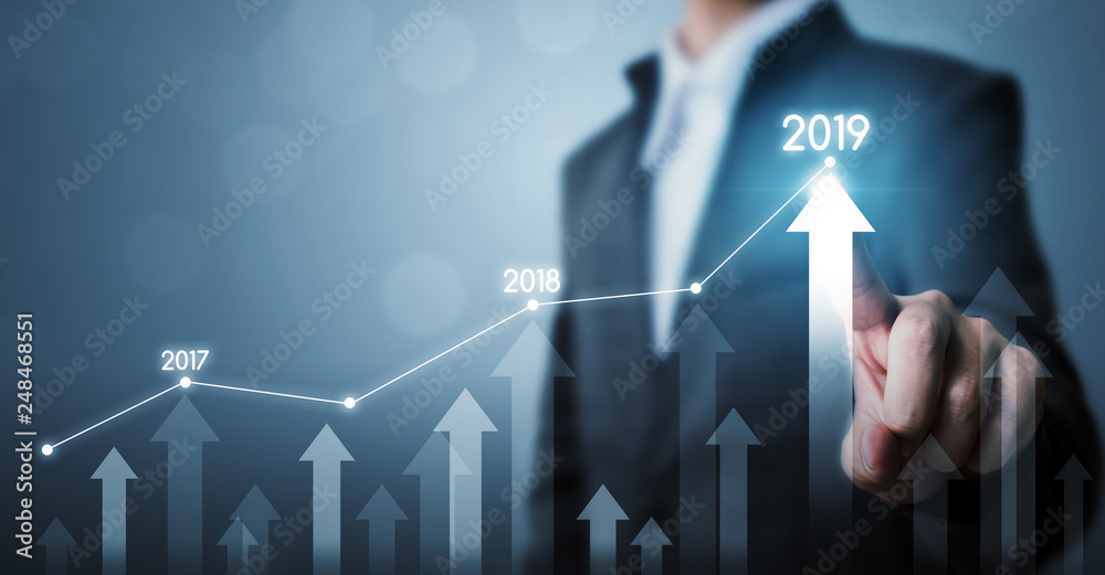 Fototapeta Business development to success and growing growth year 2019 concept, Businessman pointing line dot graph and arrow corporate future growth plan
