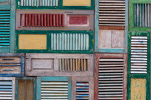 Old Weathered Wooden Doors With Broken Shutters. Detail Of The Facade  Natural Light. Patinated Wood Shutter
