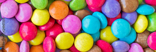Fotografiet Colorful round candies panoramic background