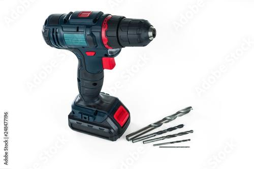 Fotografia  Cordless drill and a set of different drills