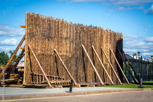Fotografie, Obraz  Medieval wooden fence made of palisade