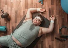 Funny Overweight Sportsman Lyi...