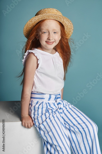 Norwegian Girl With Bright Red Hair In A Straw Hat