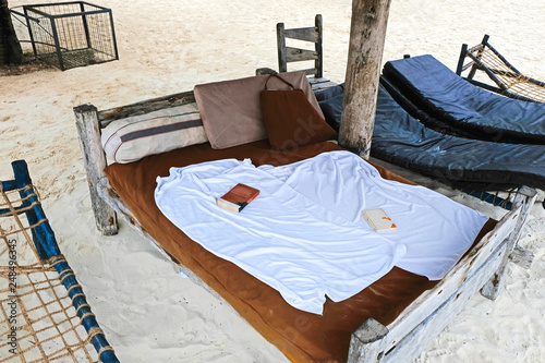 Recess Fitting Chicken Wooden empty bed with books on beach Kendwa of Zanzibar island