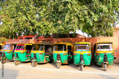 Fényképezés  Tuk-tuks parked in Taj Ganj neighborhood of Agra, Uttar Pradesh, India