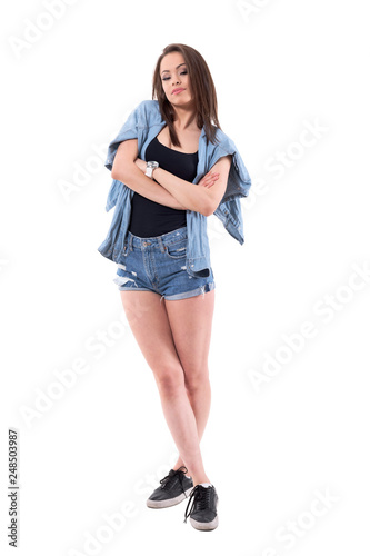 Fotografie, Obraz  Confident brunette sexy woman in denim clothes with crossed arms