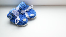 Small Baby Handmade Shoes On White Background, Motherhood Concept, Mother's Day Concept